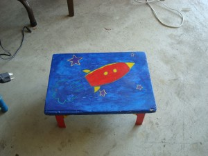 Painted Stool with rocket chip